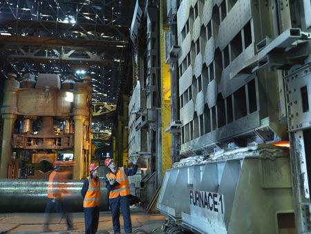 studied: Steel Engineers Inspecting Furnace LANG_EVOIMAGES