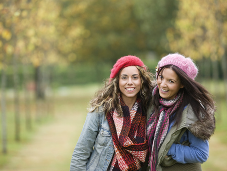 berets: Portrait of smiling women LANG_EVOIMAGES