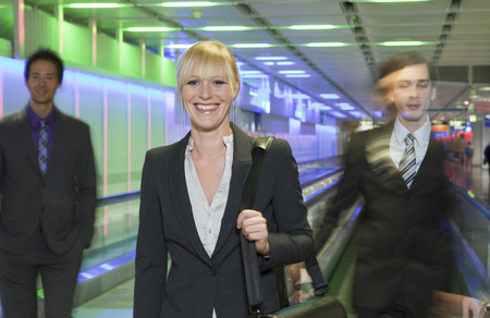 rushed: businesswoman at airport, happy