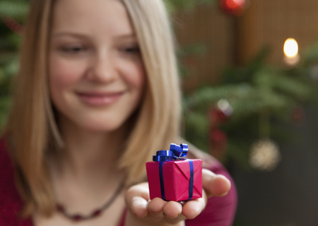 girl with small christmas present
