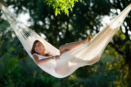 lays down: Girl in a hammock LANG_EVOIMAGES