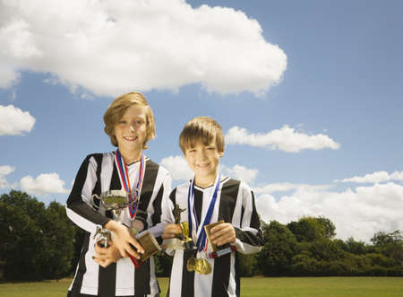prevailing: Boy footballers with Trophies