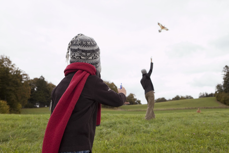 scarves: Father and son fly a kite