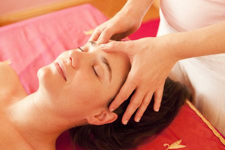 lavishly: Woman getting a facial massage LANG_EVOIMAGES