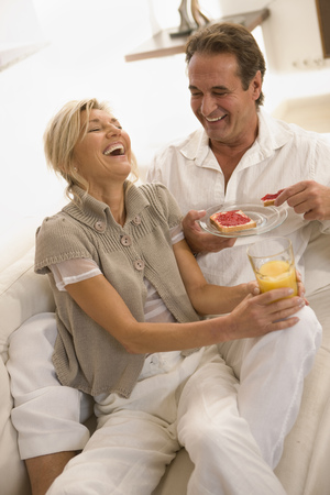 lays down: Couple having breakfast