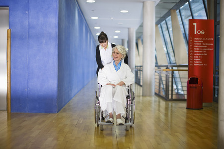 corridors: Old woman in a wheel chair and nurse
