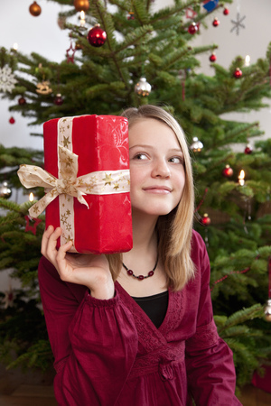 enthusiastically: girl with christmas present LANG_EVOIMAGES