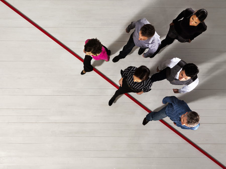 resolving: Business people crossing a red line LANG_EVOIMAGES
