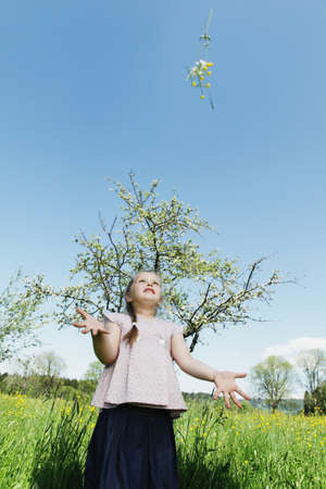 tosses: Girl at spring in the meadow