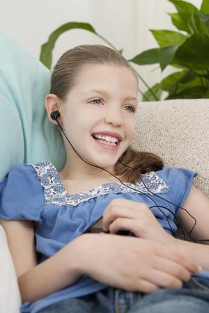 Young girl wearing head phones