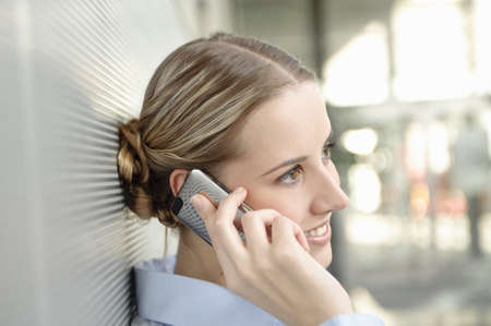 corridors: Business woman using mobile in office