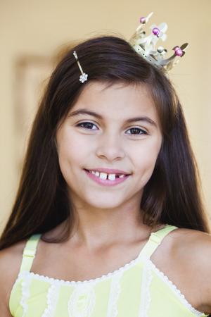 girl wearing crown smiling