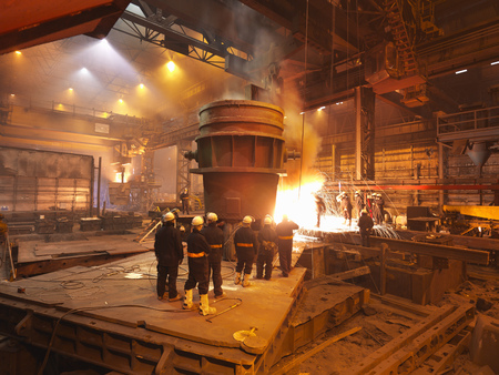 large group of business people: Steel Workers With Ladel And Sparks LANG_EVOIMAGES