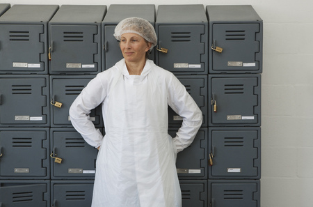 gals: factory worker relaxing against locker
