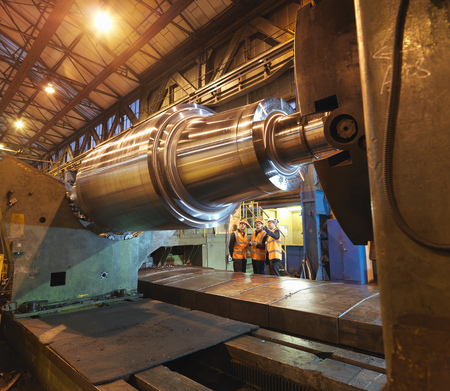 viewed: Engineers Inspecting Forged Steel Roller