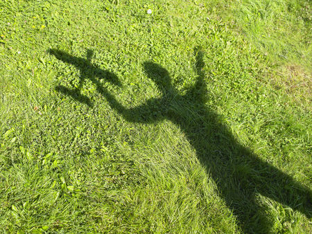 high flown: Shadow of a woman holding an rc plane