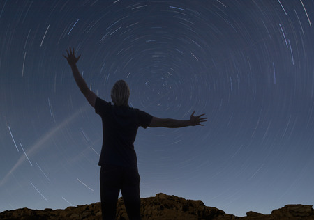 stargaze: man watching the starry night sky