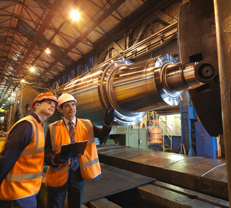 large group of business people: Engineer & Apprentice With Steel Roller LANG_EVOIMAGES
