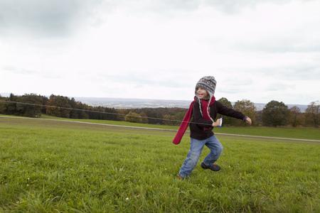 tugging: Boy fly a kite