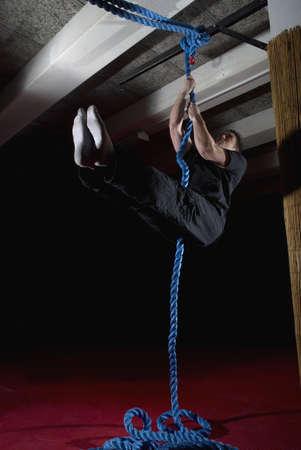dangling: man doing rope exercises