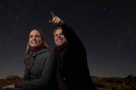 taught man: couple watching the starry night sky