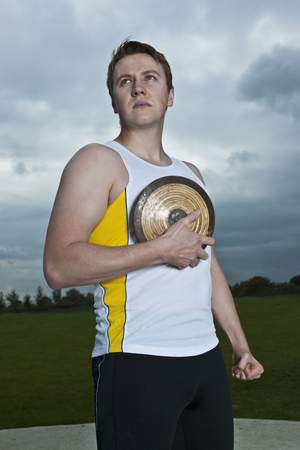 discus: Male athlete posing with discus LANG_EVOIMAGES