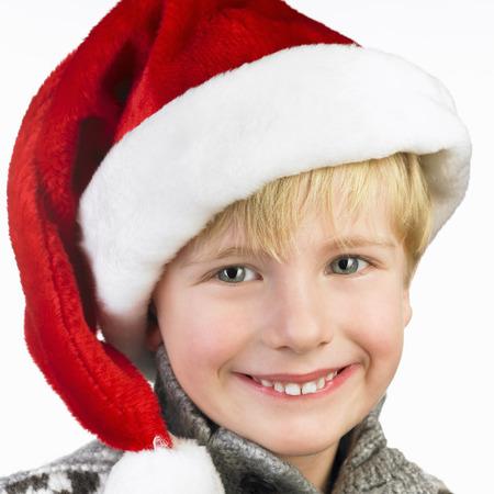 xmass: Boy wearing a christmas hat