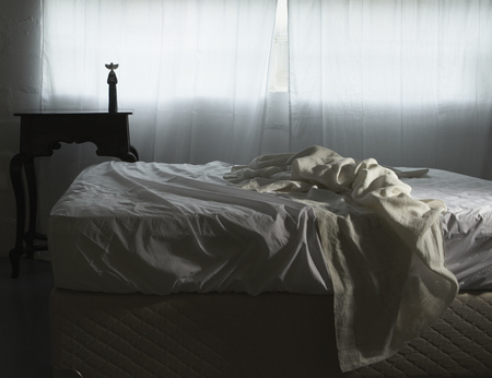 unmade: Unmade bed in morning light