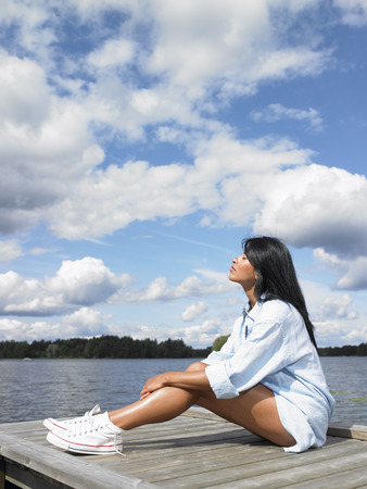 basking: Woman reconnecting with nature LANG_EVOIMAGES