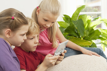 viewed: Children playing a game on a console LANG_EVOIMAGES