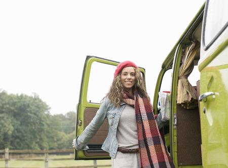 berets: Portrait of woman next to camper van
