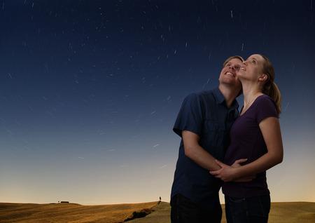 stargaze: couple watching the starry night sky