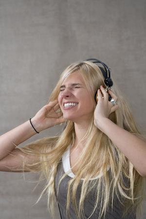 pubescent: Teen girl wears head phones