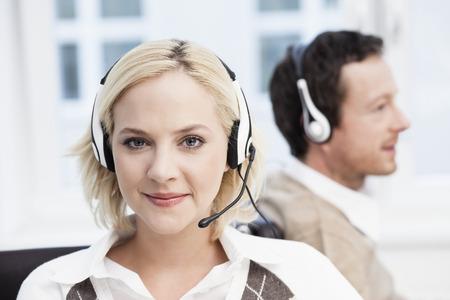 handsfree telephones: Female call center agent portrait