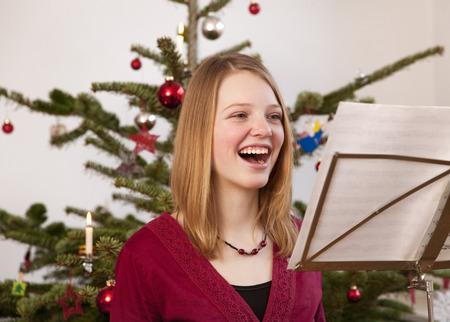 one sheet: girl singing christmas carols