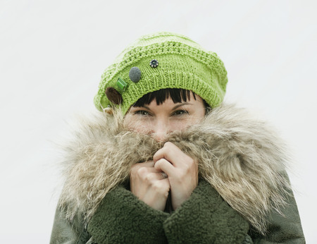 obscure: Portrait of woman in winter clothing