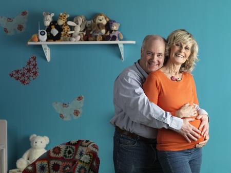 Pregnant older woman with male partner LANG_EVOIMAGES