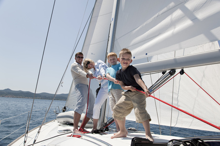 joyous: Family pulling rope on yacht LANG_EVOIMAGES
