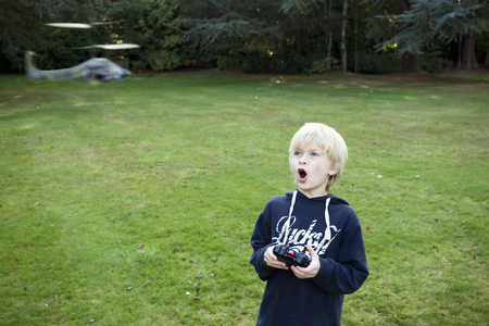 coordinating: Boy with remote Helicopter LANG_EVOIMAGES