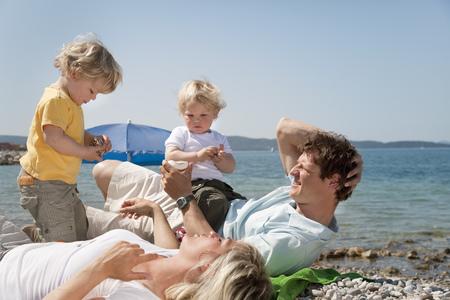 Family at the beach looking at shells