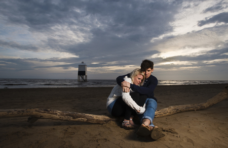 sooth: Couple on beach at sunset