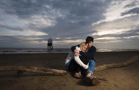 heartache: Couple on beach at sunset