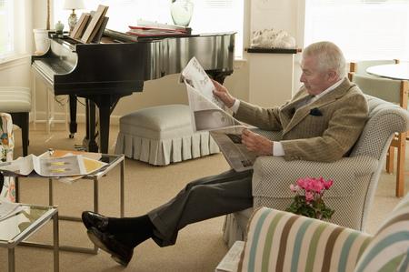 ninety's: Senior man reading newspaper
