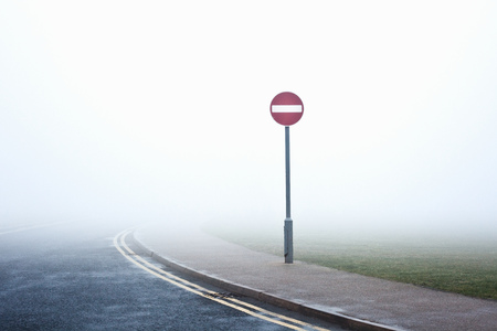 do not enter: Road with no entry sign in fog LANG_EVOIMAGES