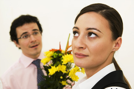Women ignores man offering flowers