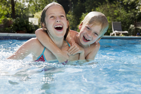 Girl and Boy in Swimming pool LANG_EVOIMAGES