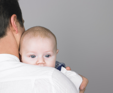 cherished: Baby on fathers shoulder