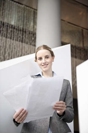 toils: Businesswoman looking at paperwork