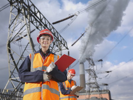 in twos: Female Worker At Power Station LANG_EVOIMAGES