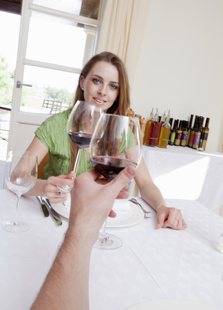 Couple at restaurant toasting with wine